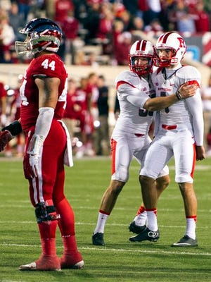 Rutgers place kicker Kyle Federico, right, and Joey Roth celebrate after Federico kicked a 26-yard field goal as time expired to defeat Indiana 55-52 in an NCAA college football game, Saturday, Oct. 17, 2015, in Bloomington, Ind. AP Photo/Doug McSchooler)