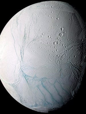 FILE - This June 28, 2009 image provided by NASA, taken by the international Cassini spacecraft, shows Enceladus, one of Saturn's moons. NASA's Cassini spacecraft has detected hydrogen molecules in the geysers shooting off the ice-encrusted ocean world, possibly the result of deep-sea chemical reactions between water and rock that could spark microbial life, according to findings announced Thursday, April 13, 2017 in the journal Science.