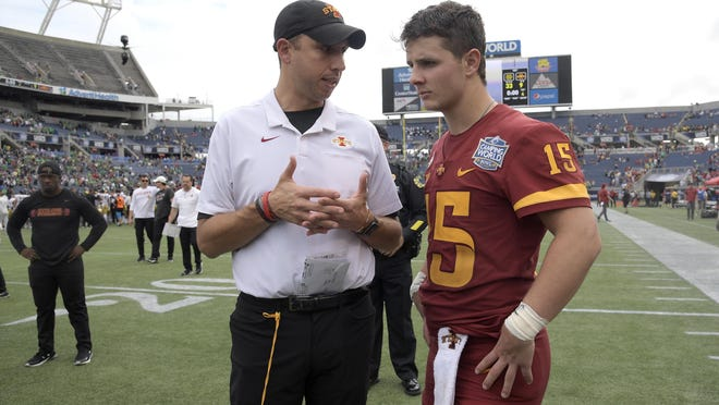 Iowa State head coach Matt Campbell, left, talks with quarterback Brock Purdy (15) on the field after the Camping World Bowl NCAA college football game against Notre Dame Saturday, Dec. 28, 2019, in Orlando, Fla.