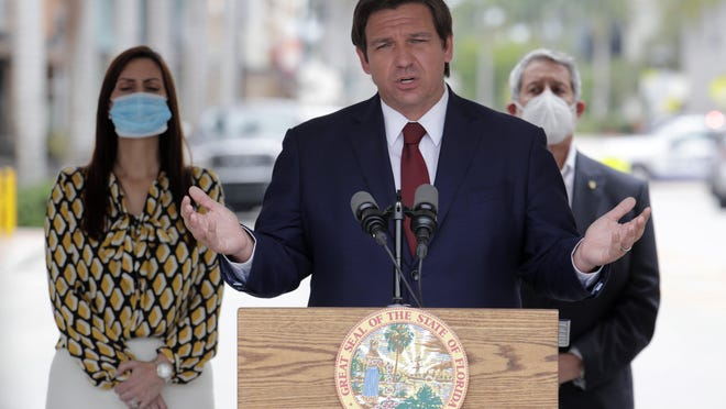 Florida Gov. Ron DeSantis speaks at a news conference in May.