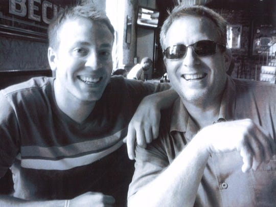 Kelly Lytle, on vacation with his dad in 2010, wrote a book in his grief.