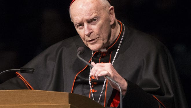 """FILE - In this Wednesday, March 4, 2015, file photo, Cardinal Theodore Edgar McCarrick speaks during a memorial service in South Bend, Ind. Pope Francis has accepted U.S. prelate Theodore McCarrick's offer to resign from the College of Cardinals following allegations of sexual abuse, including one involving an 11-year-old boy, and ordered him to conduct a """"life of prayer and penance"""" in a home to be designated by the pontiff until a church trial is held, the Vatican said Saturday, July 28, 2018. (Robert Franklin/South Bend Tribune via AP, Pool, File)"""