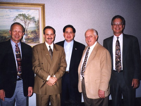 Great Falls Dodgers executives Larry Geske, left, and Jim Keough, right, pose with members of the Los Angeles Dodgers front office in this 1999 file photo. Pictured are LA general manager Kevin Malone, second from left, farm director Bill Geivett, middle, and vice president Tommy Lasorda, second from right.