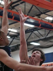Lexington's Jonah Yaussy goes up for two of his 33