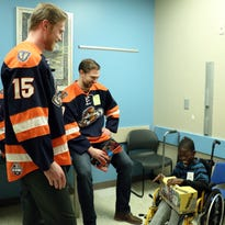 Swamp Rabbits bring holiday cheer to Shriners patients