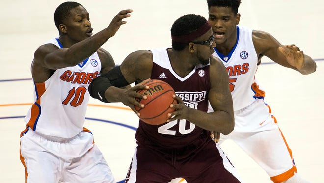 Florida's Dorian Finney-Smith (10) and John Egbunu defend Mississippi State's Gavin Ware in the second half on Tuesday. The Bulldogs blew a double-digit lead and lost 81-78 and fell to 0-5 in SEC play.
