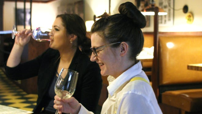 Cello staffers Leanne Miller, in foreground and Jenna Nicklowitz participate in a wine training -- and tasting -- event at the restaurant.