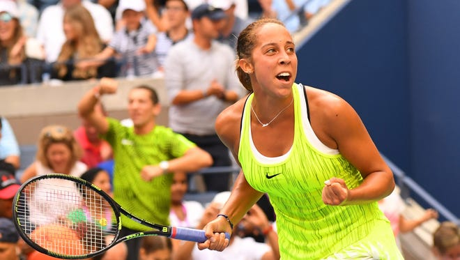Madison Keys of the United States reacts after beating Naomi Osaka of Japan on Day 5 of the U.S.