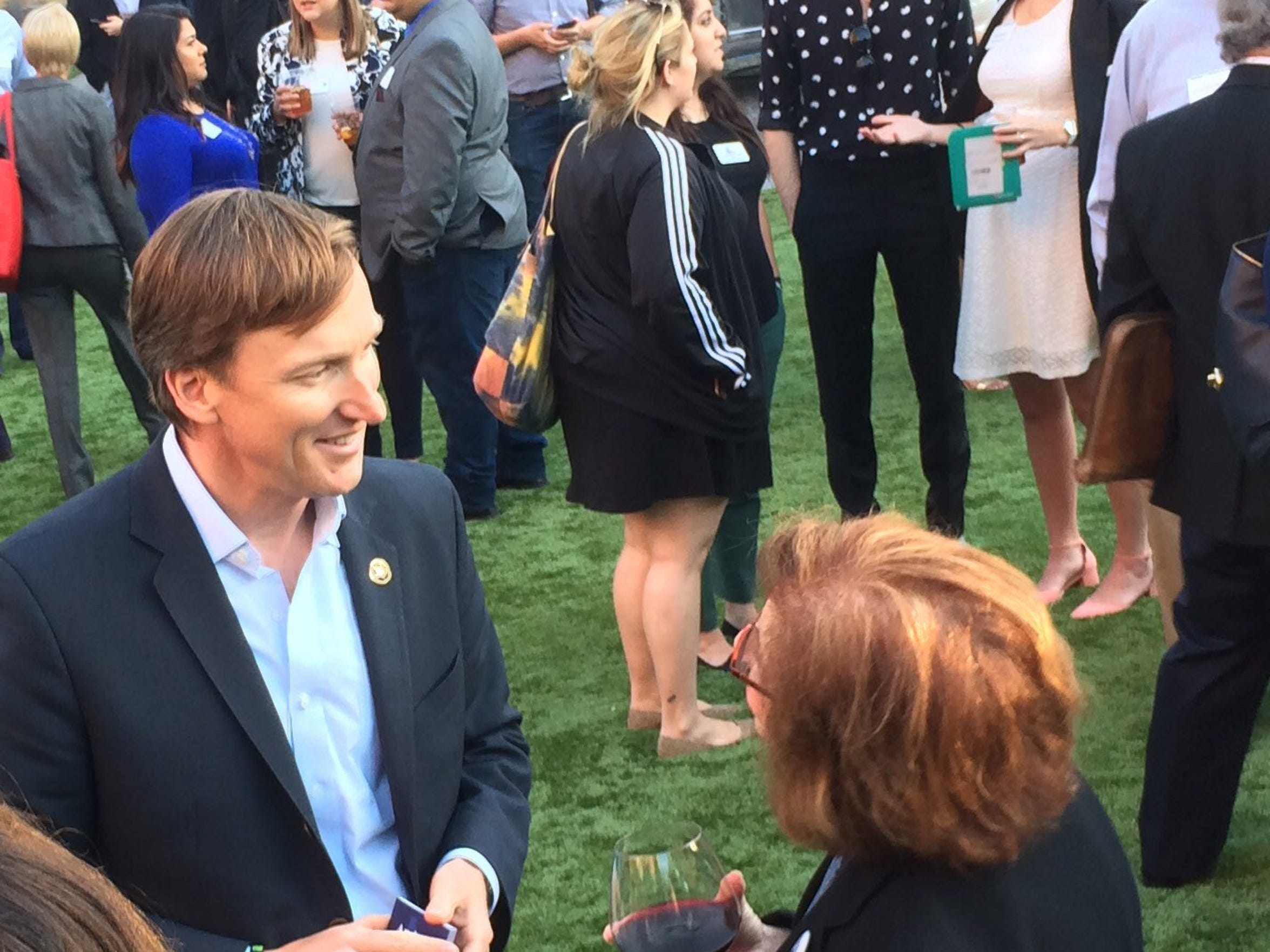 Andrew White chats with Democrats at party event in Austin on April 14, 2018.