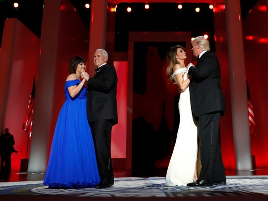 President Donald Trump dances with first lady Melania Trump as Vice President Mike Pence dances with his wife Karen at the Liberty Ball, Friday, Jan. 20, 2017, in Washington.