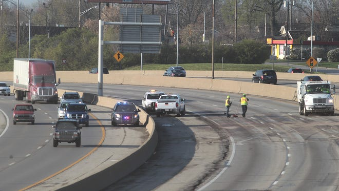 Workers clean the northbound lanes of Interstate 75 near Shepherd Lane after a fatal crash on April 8.