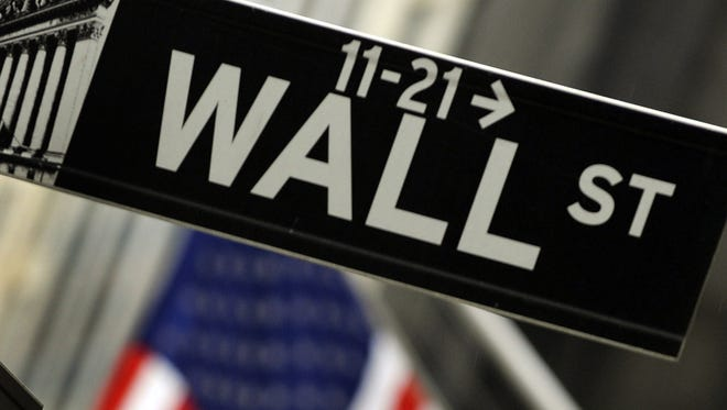 (FILES) A sign for Wall Street is seen before the opening bell in this October 15 2009 file photo.  US stocks opened sharply lower on October 14, 2013 with the government faced with just four days to resolve the political deadlock over the budget and debt before being forced to default on its bills. After a weekend that saw no progress in talks between the White House and Republicans, five minutes into trade, the Dow Jones Industrial Average was down 76.10 points (0.50 percent) at 15,161.01.The broader S&P 500 lost 8.41 (0.49 percent) to 1,694.79, and the Nasdaq Composite gave up16.27 (0.43 percent) to 3,775.60. AFP PHOTO/TIMOTHY A. CLARYTIMOTHY A. CLARY/AFP/Getty Images ORIG FILE ID: 523773135