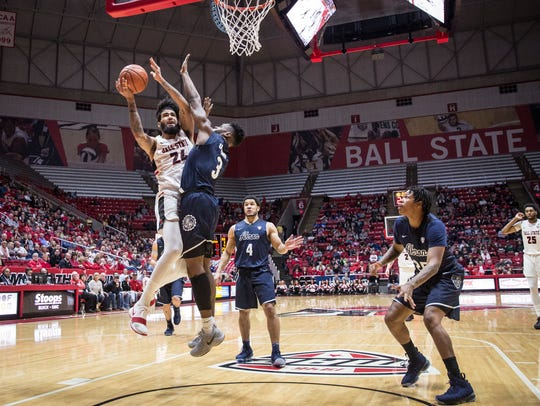 Ball State's Trey Moses drives into the basket for