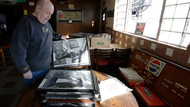 Al Repp looks at photos that were on the wall at Repps Bar located on the corner Oshkosh Avenue and Rainbow Drive in Oshkosh, Wis., February 1, 2018.  Repp closed the bar at the end of December sold the building recently.  He is taking his time going through almost 75 years of history at the bar.Joe Sienkiewicz / USA TODAY NETWORK-Wisconsin