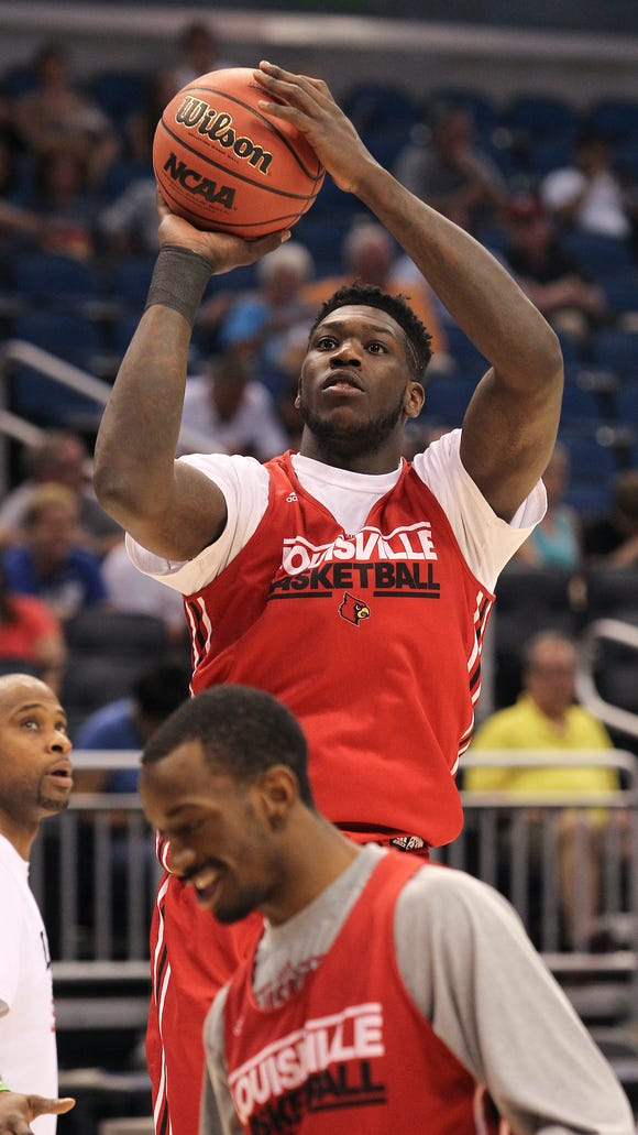 U of L's Montrezl Harrell shoots during a public practice ahead of their NCAA matchup with Manhattan at the Amway Center in Orlando, Fl. Mar. 19, 2014