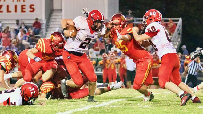 El Dorado senior, Zach Wittenberg (2) runs against the Labette County defense on Friday, Sept. 18 at Labette County High School in Almont, Kansas. El Dorado won 30-14 to improve to 2-1 on the year