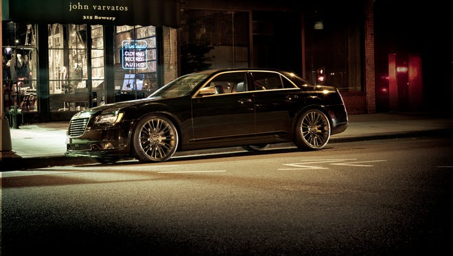 A face-smacking grille, wide hood, bunkered windows and tall decklid give the Chrysler 300C substantial presence.