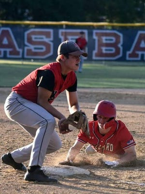 Ballard plays North Polk on Tuesday in high school baseball in Slater, Iowa. The state plays high school baseball and softball in summer, but many are concerned about the relaxed attitude fans have toward social distancing recommendations to stop the spread of the novel coronavirus.