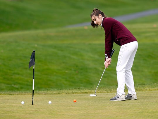 Madison's Nicole Artigliere on the putting green before their girls golf tri-match vs. Morristown and Mendham at Pinch Brook Golf Course. April 19, 2018. Florham Park, NJ.
