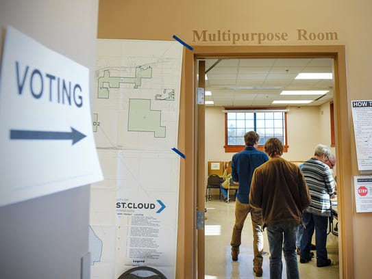 People make their way into the polling place to vote