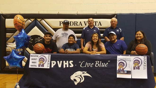 Piedra Vista's Nykki Benally signs a letter of intent to play basketball for Haskell Indian Nations University on Thursday.