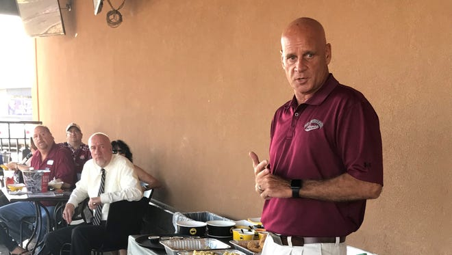Aggie Head Football Coach Doug Martin talks about Aggie football to folks at the Aggie Caravan gathering at Buffalo Wild Wings, 839 S. White Sands Blvd., in Alamogordo.