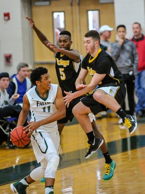 St. Joseph's Letrell West (11) looks to pass the ball despite tight defense by South Brunswick's Tavian Alford (left) and Vic Heutz during Saturday's game in Metuchen.