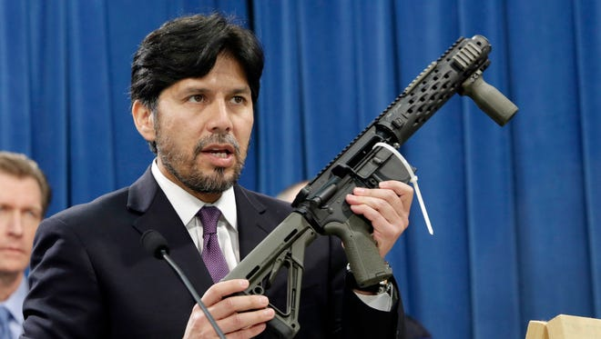 In this Jan. 13, 2014, file photo, California State Sen. Kevin de Leon, D-Los Angeles, displays a homemade fully automatic rifle, confiscated by the Department of Justice, at the Capitol in Sacramento.