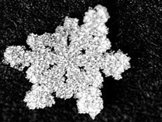 Resembling a broken diamond brooch. this snowflake's form has an elegance.