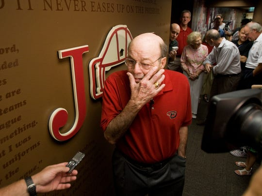 Joe Garagiola wipes away a tear after walking through