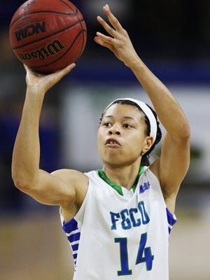 KINFAY MOROTI/THE NEWS-PRESS.. FGCU's Whitney Knight scores against Northern Colorado on Friday (12/19/14) at Alico Arena in Fort Myers.