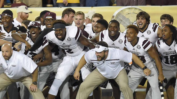 The Mississippi State sideline gets rowdy for the kickoff Saturday night, September 5, 2015, at M.M. Roberts Stadium on the University of Southern Mississippi campus in Hattiesburg, Miss.