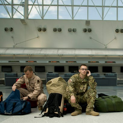 U.S. service members are seen entering and leaving the United Service Organization at the Baltimore Washington International airport June 5, 2012.