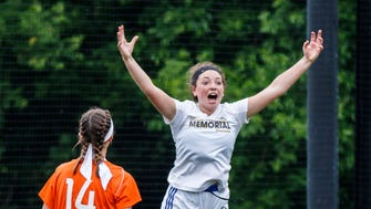 Catholic Memorial junior Shannon McWilliams (19) celebrates a goal during the sectional championship game against Grafton at Haertel Field in Waukesha on Saturday, June 9, 2018.