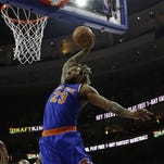 The Knicks' Derrick Williams goes up for a dunk against the Philadelphia 76ers' Richaun Holmes during the first half of Friday's game.