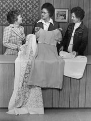 Lois O'Dell (left), Margaret Smith and Margaret McCarty hold donated items at the Thrift House in an undated photograph published in the Abilene Reporter-News Feb. 2, 1975 after a remodel at the resale store. The Thrift House has been a ministry of the Church of the Heavenly Rest since Sept. 15, 1952.