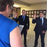 Richmond mayor Sally Hutton swears in Jesse Tyree, center, and Chase Patton as members of the Richmond Police Department on Monday.
