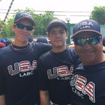 Bishop Verot's Fletcher Reynolds, left, and Canterbury's Aaron Gebig, center, pose with their Team USA coach during the Latin American Baseball Classic in Santa Domingo, Dominican Republic. from Aug. 6-12. The team went 2-2.