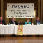 Democratic Senate candidates from left to right: Tom Fiegen, Rob Hogg, Patty Judge and Bob Krause attend Sunday's Star*Pac forum in Des Moines. Despite the banner in the background, they are not presidential candidates.