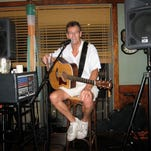 John Lowbridge learned how to play the guitar at age 12 and has been a professional musician since the early Beatles era. He belts out a rock 'n' roll song during his weekly Thursday evening performance at Riverwalk in Naples' Tin City. Lowbridge hails from the tradition of British pub performers who tell jokes and chat up the audience members as well as sing and play for them.