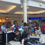 "A line forms for ""KIDSday"" at Eastview Mall."