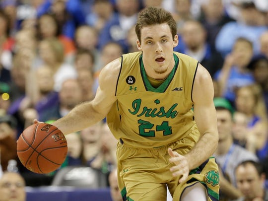 Notre Dame's Pat Connaughton (24) pushes the ball up
