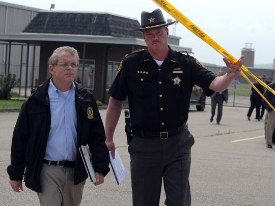 Attorney General Mike DeWine and Pike County Sheriff Charles Reader walk up to a press conference April 27 in Waverly.