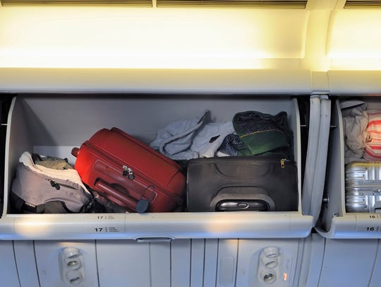 In order to avoid checked-baggage fees, more people