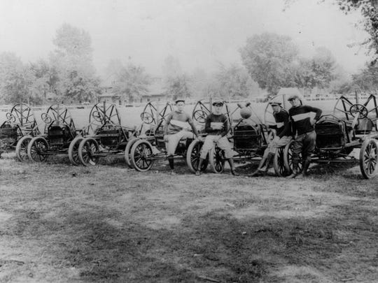 """Drivers in front of their trusty """"steeds"""" at the Indiana State Fairgrounds for Hankinson's Auto Polo in 1916.  It was a sport that could only be described as a combination of demolition derby with a large ball and polo mallets. The first known event in Indianapolis was held at Washington Park in 1913."""
