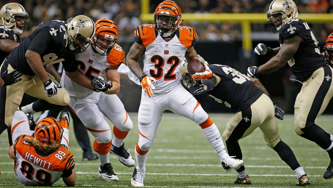 The Cincinnati Bengals running back Jeremy Hill (32) runs the ball against the New Orleans Saints at the Superdome in New Orleans.  The Enquirer/Jeff Swinger