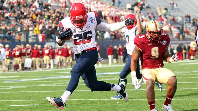 Arizona Wildcats running back Ka'Deem Carey (25) carries the ball into the end zone against Boston College at Independence Stadium in Shreveport, La. on Dec. 31, 2013.