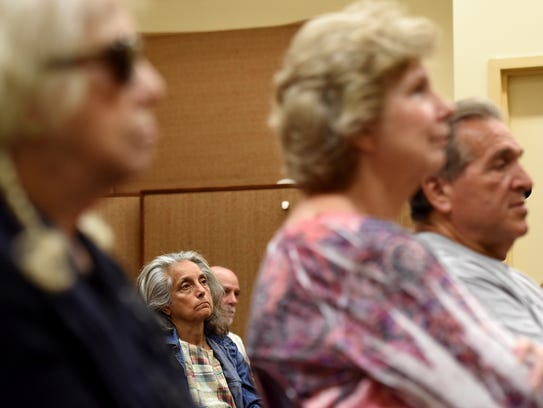 Attendees of talk at Nutley Public Library listen to