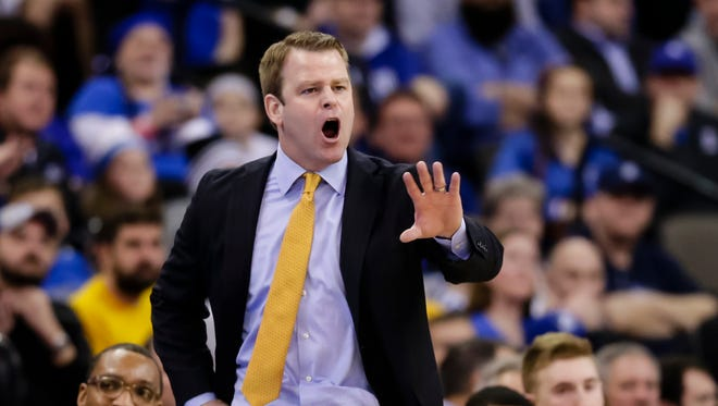 Marquette coach Steve Wojciechowski calls instructions during the first half  against Creighton in Omaha, Neb., Jan. 21.