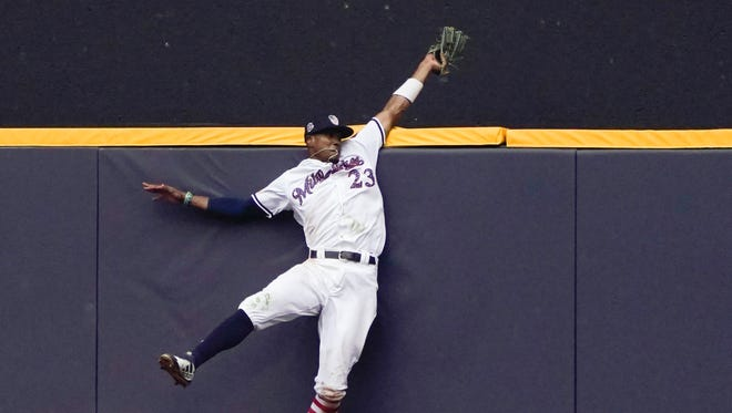 Milwaukee Brewers' Keon Broxton makes a leaping catch at the wall on a ball hit by Minnesota Twins' Brian Dozier during the ninth inning of a baseball game Wednesday, July 4, 2018, in Milwaukee. (AP Photo/Morry Gash) ORG XMIT: WIMG1